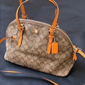 Coach purse with light orange trim.